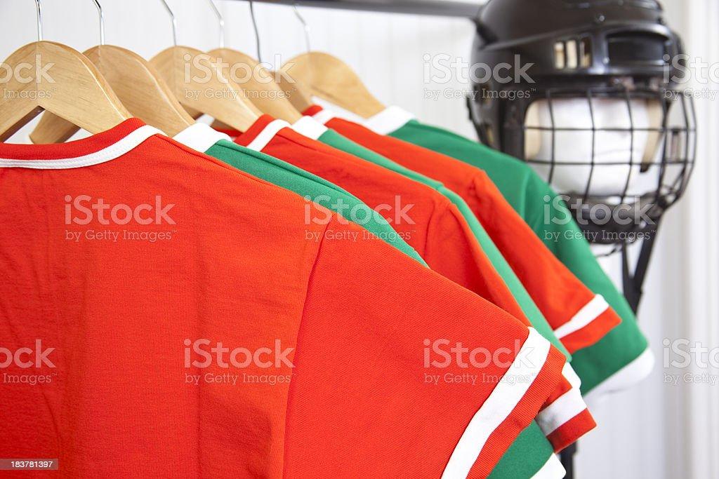 Hockey helmet and jerseys in sports shop royalty-free stock photo