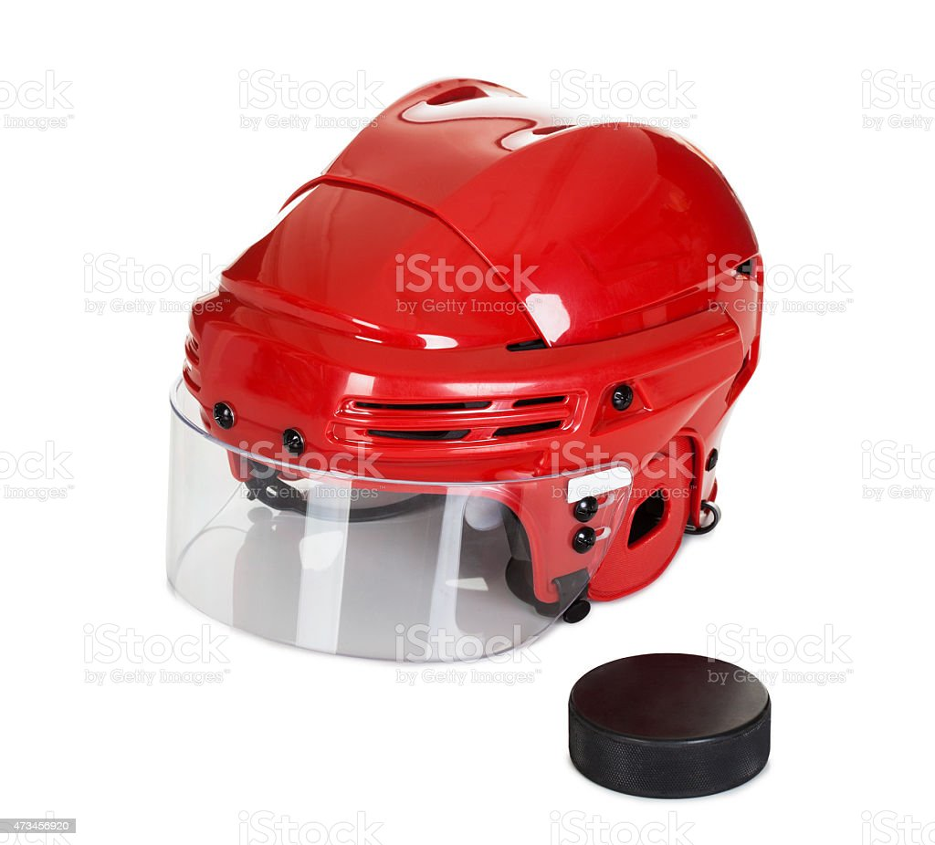 Hockey helmet and puck stock photo