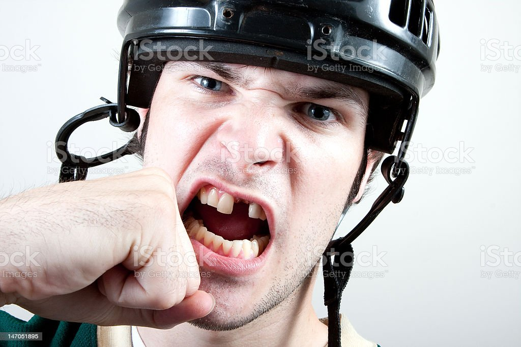 Hockey player getting punched stock photo