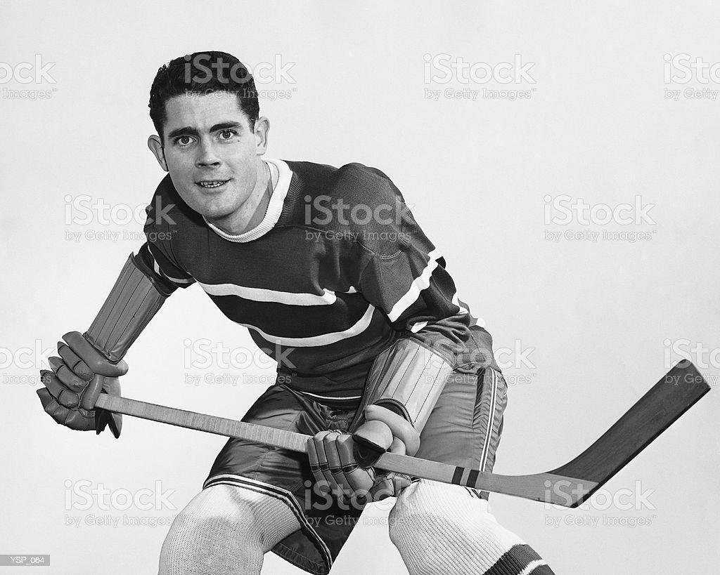 Hockey player holding stick royalty-free stock photo