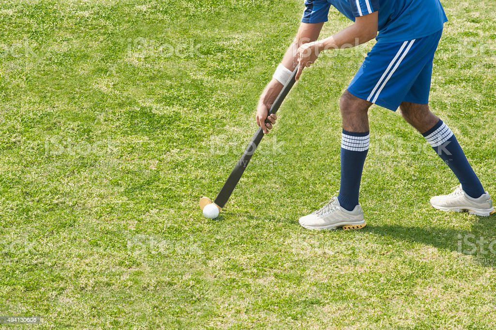 Hockey player in a field stock photo