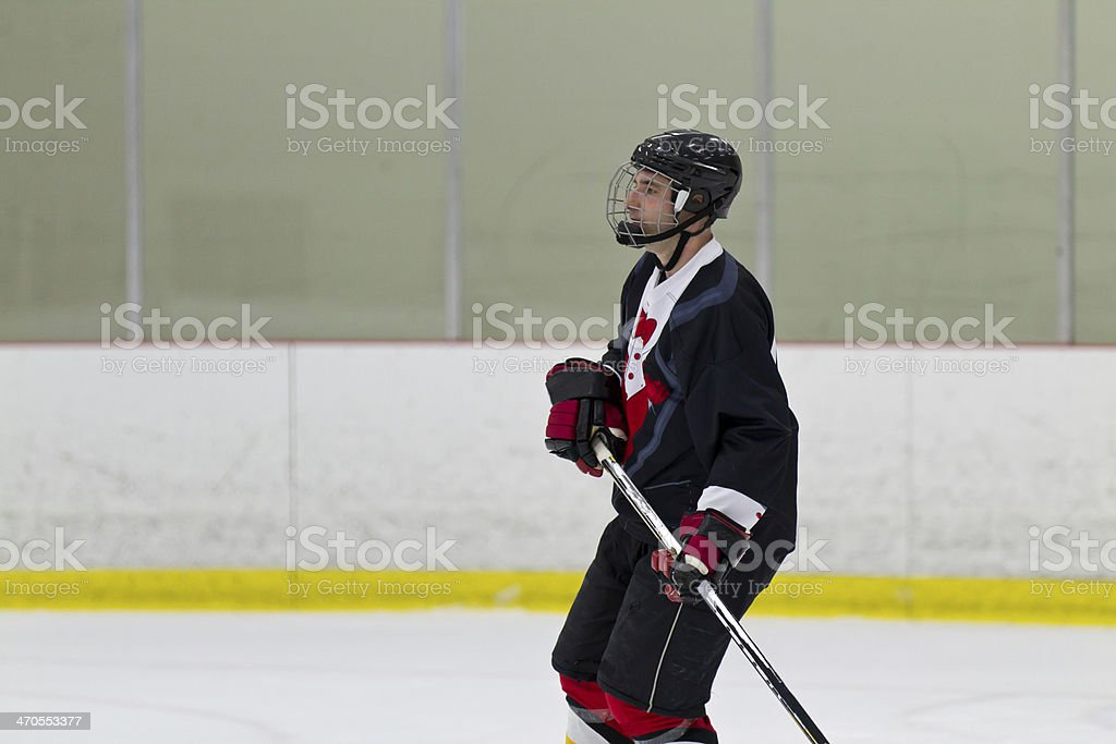 Hockey player in an arena royalty-free stock photo