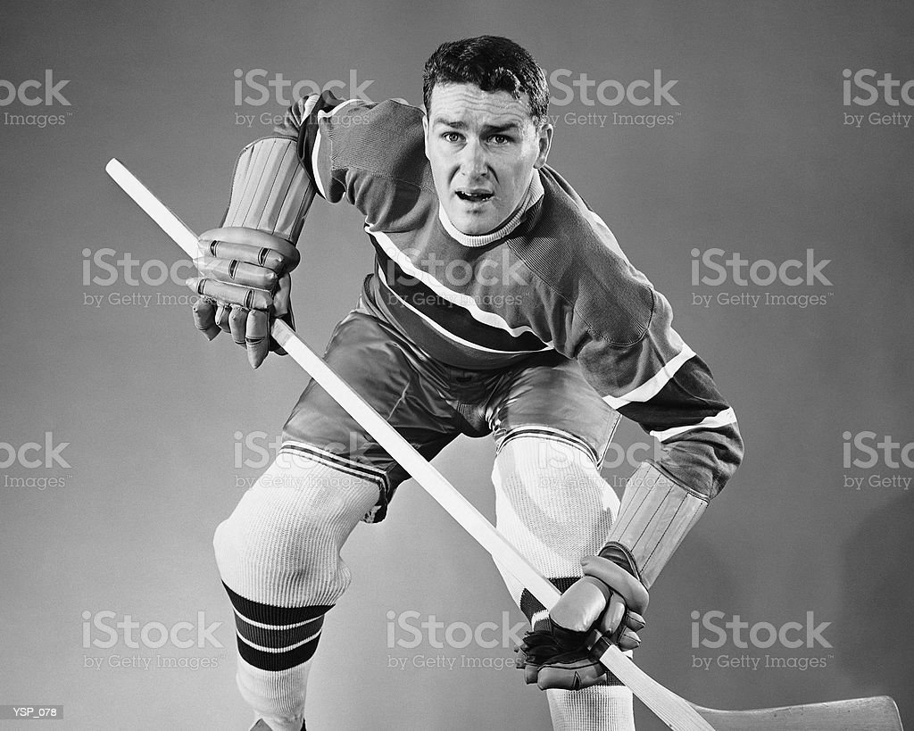 Hockey player in defensive stance royalty-free stock photo
