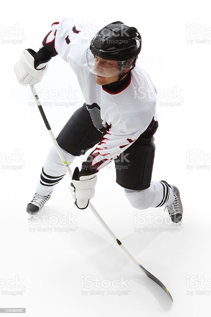 Hockey player on ice playing hockey royalty-free stock photo