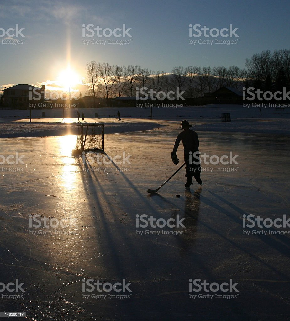 Hockey Player on Outdoor Ice Rink royalty-free stock photo