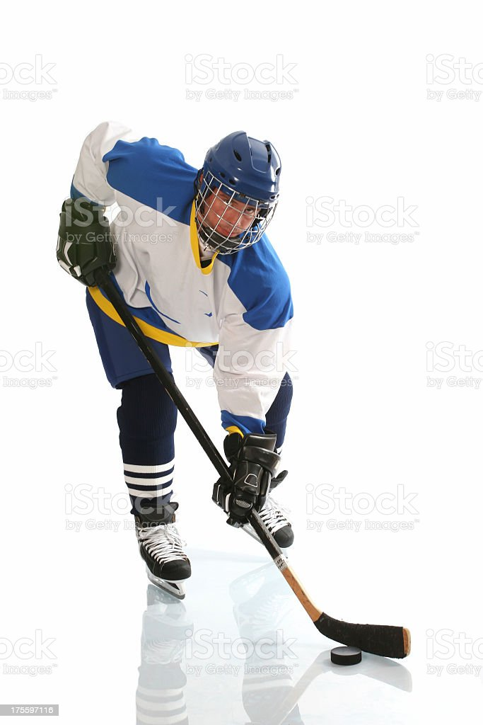 Hockey player shooting the puck royalty-free stock photo