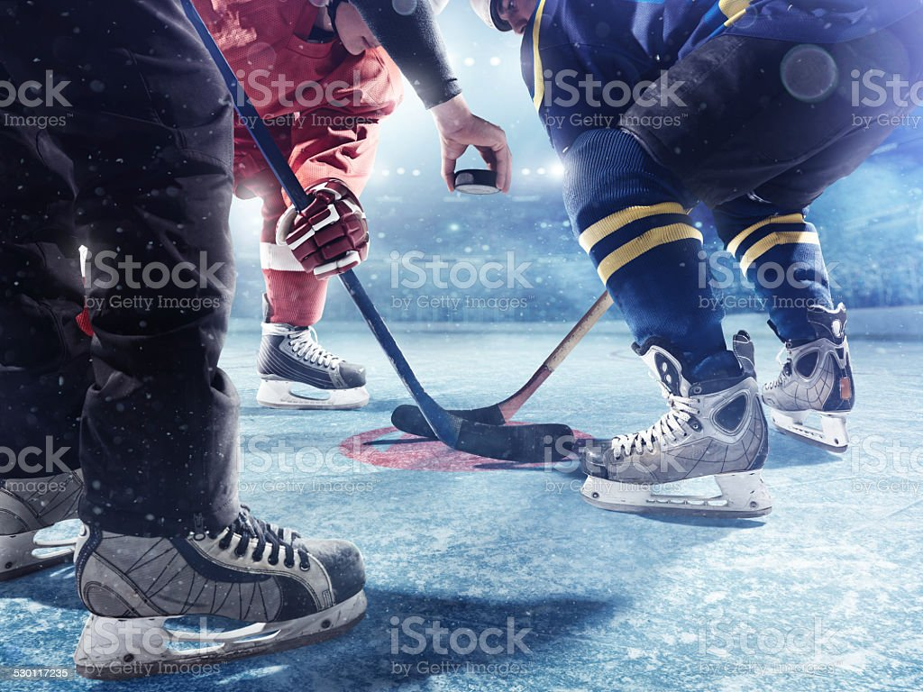 Hockey players and referee start of the match stock photo