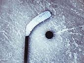 hockey puck and stick on the ice texture background