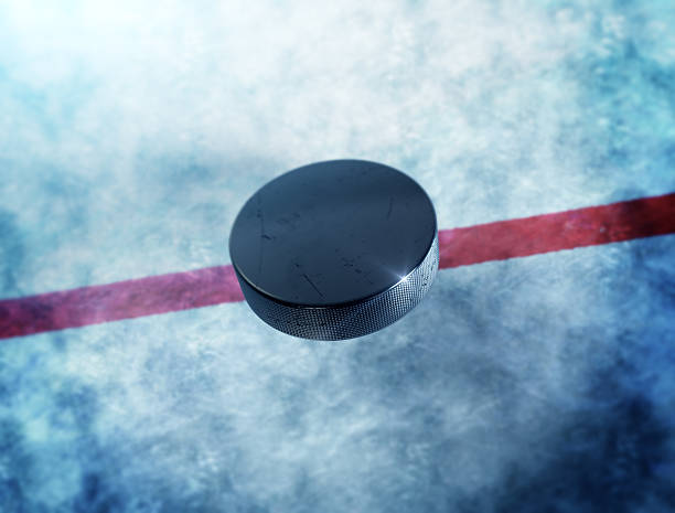 hockey puck center - hockey puck stock photos and pictures