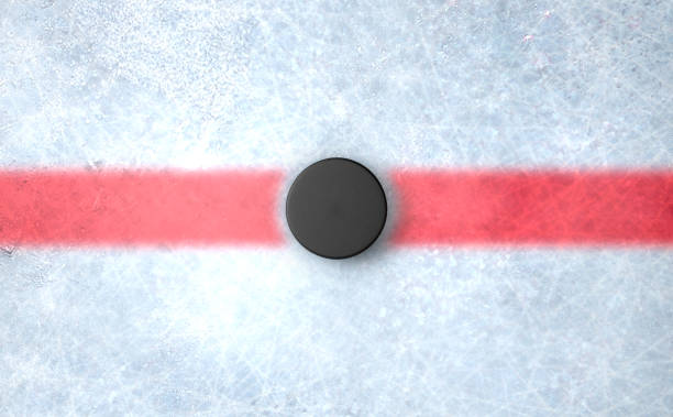 hockey puck centre - hockey puck stock photos and pictures