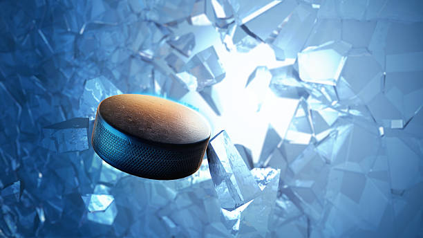 Hockey puck in water with view of broken ice above stock photo