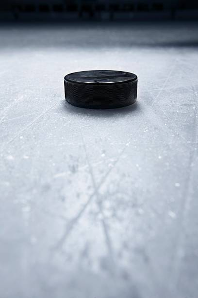 Hockey Puck on Ice stock photo