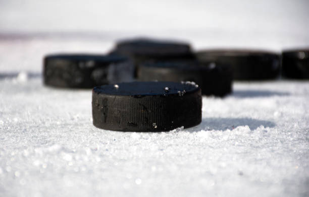 Hockey puck on ice.Hockey puck. Hockey puck on ice.Hockey puck. padding stock pictures, royalty-free photos & images