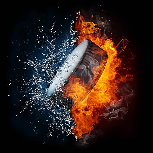 disco da hockey - ice on fire foto e immagini stock