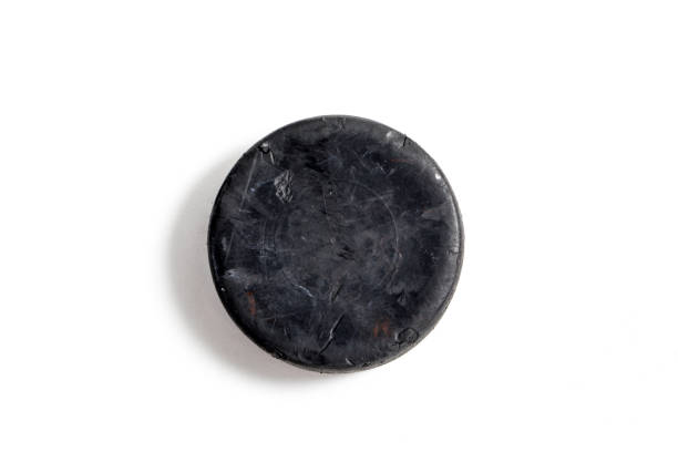 hockey puck - hockey puck stock photos and pictures