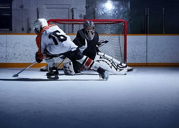 Hockey-Spieler schießen Out – Foto