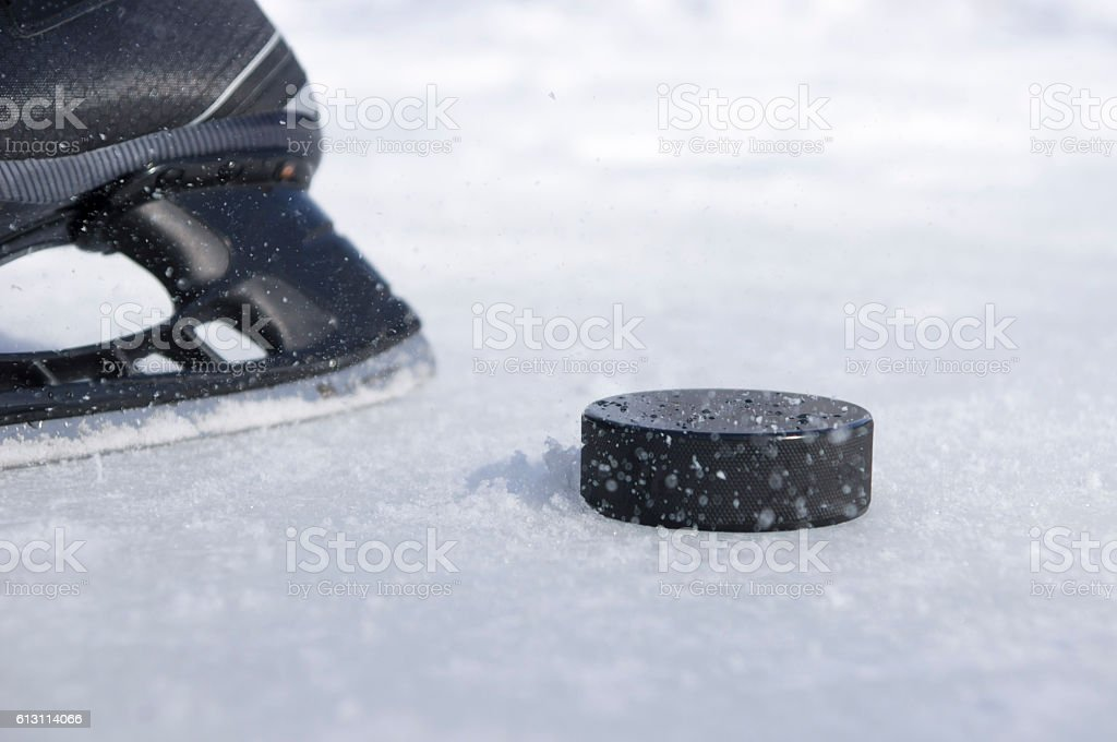 hockey skate and puck stock photo