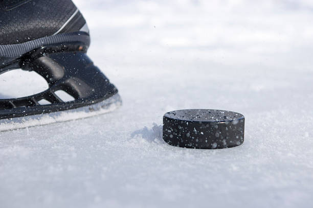 hockey skate and puck - hockey puck stock photos and pictures
