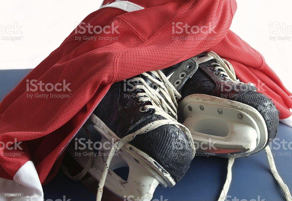 Hockey Skates and  Red Jersey royalty-free stock photo
