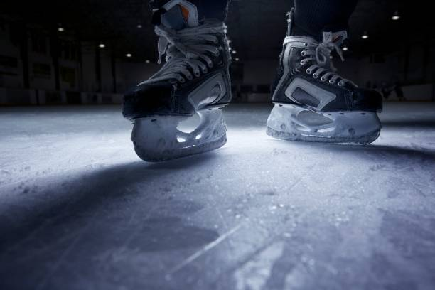 hockey skates on ice - hockey stock pictures, royalty-free photos & images