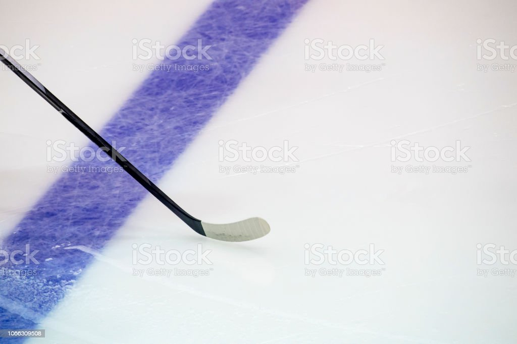 Hockey Stick a on the Ice Rink. Winter sport