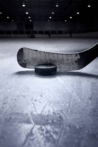 hockey stick and puck - hockey stock pictures, royalty-free photos & images