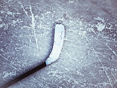 hockey stick on the ice texture background