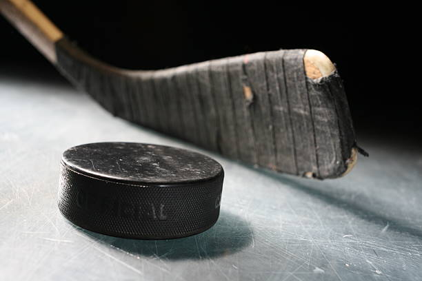 hockey stick & puck - hockey stick stock pictures, royalty-free photos & images