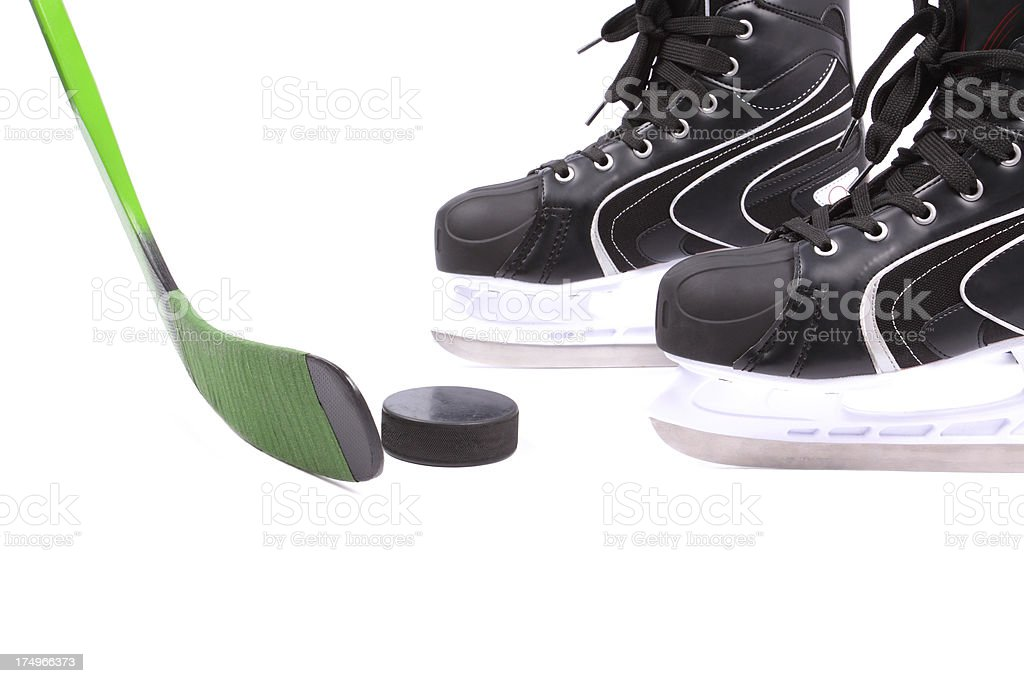 Hockey stick, skates and puck royalty-free stock photo