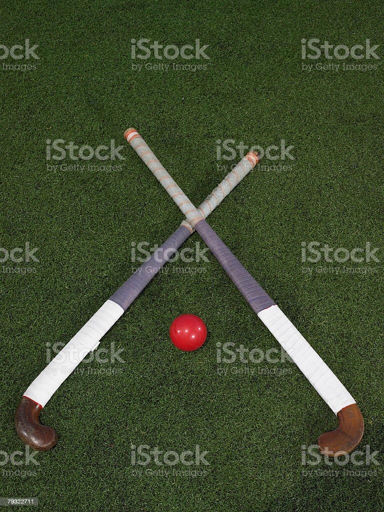 Hockey sticks and a ball stock photo