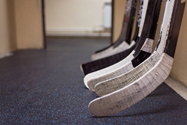 Hockey sticks in locker rooms before the game stock photo