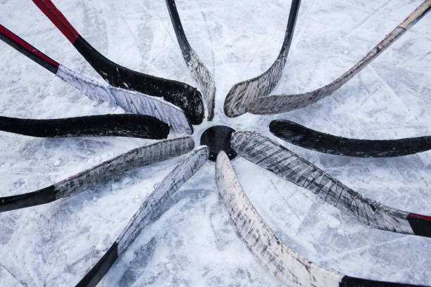 hockey team put putter around the washer - hockey stock pictures, royalty-free photos & images