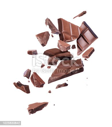 istock Ð¡hocolate broken into pieces in the air on a white background 1025830842