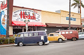 OCEAN BEACH, SAN DIEGO, CALIFORNIA / USA - MAY 01, 2018: A local favorite burger restaurant in Ocean Beach, California with several vintage Volkswagen cars and buses parked in front.