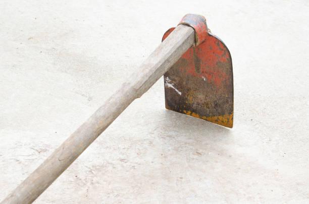 hoe on floor Backyard Garden  iron hoe hoe iron garden hoe stock pictures, royalty-free photos & images