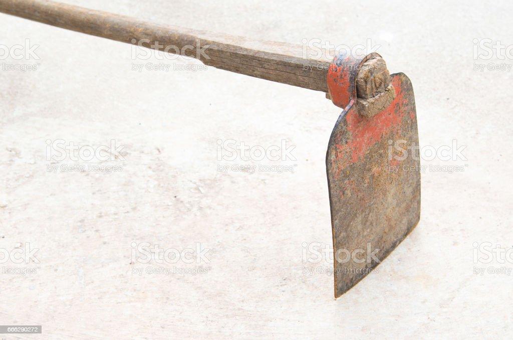 hoe on floor Backyard Garden  iron hoe stock photo