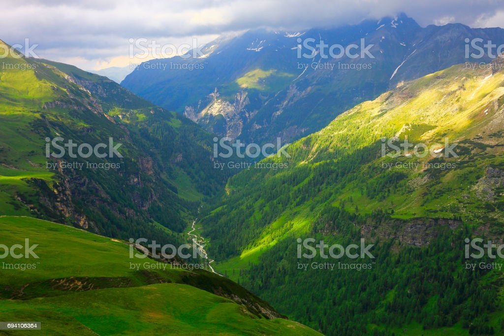 Hohe Tauern Snowcapped Austrian mountain range - Tirol Alps dramatic cloudscape Sky and landscape and Grossglockner Massif stock photo