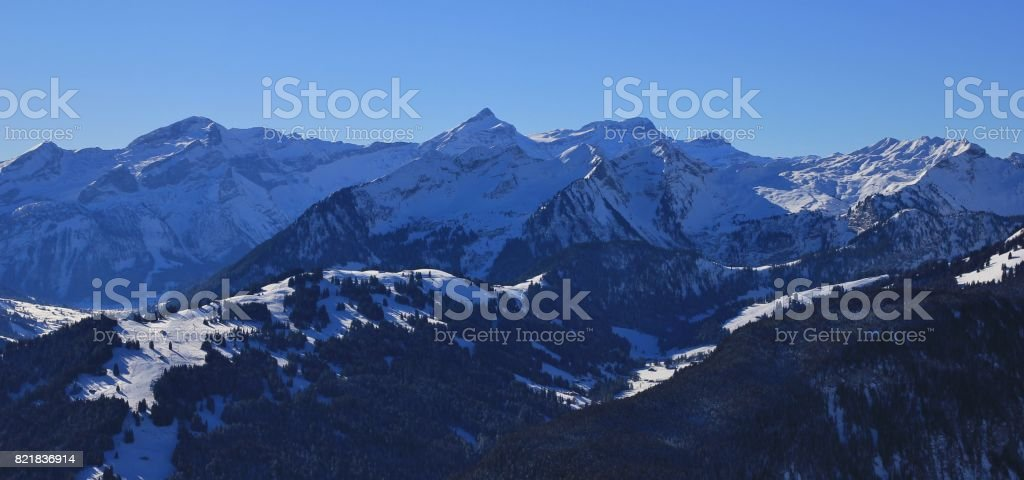 Hohe Wispile, Oldenhorn and other snow covered mountains near Gstaad. stock photo