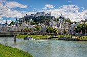 Great view on Festung Hohensalzburg with Salzach river and Makartsteg bridge in Salzburg, Austria