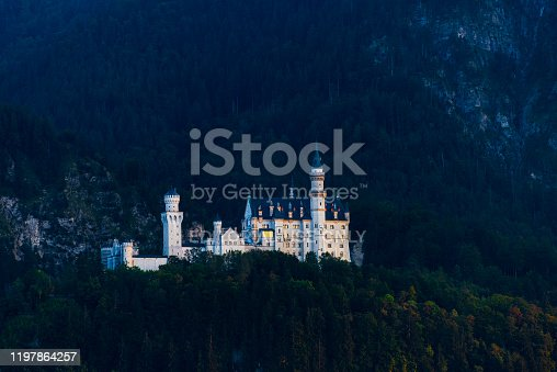 Fussen, Germany - August 18, 2018: The beautiful castle of Hohenschwangau in Schwangau, Germany. This historic XIX century construction was build by king Maximilian II of Bavaria on a hill surrounded by a beautiful landscape of mountains forest and lakes.