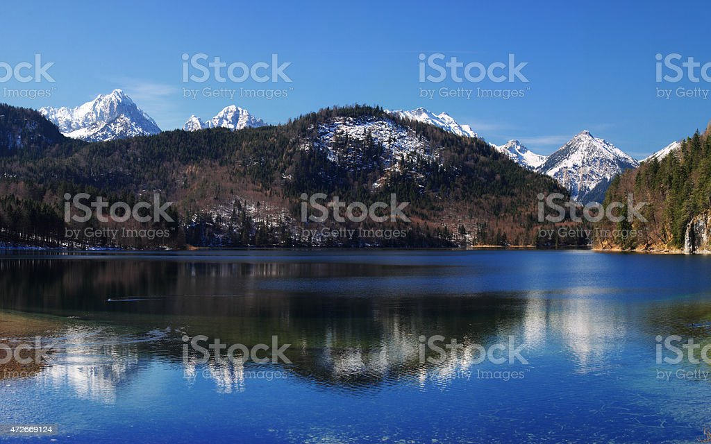 Hohenschwangau lake with bavarian alps in Germany stock photo