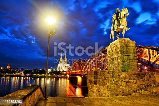 Kaiser Wilhelm Monument on the Hohenzollern Bridge at night in Cologne, Germany. Composite photo