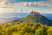 Hechingen, Germany - May 19, 2016: Aerial view of famous Hohenzollern Castle, ancestral seat of the imperial House of Hohenzollern and one of Europe's most visited castles, in beautiful golden evening light, Baden-Wurttemberg, Germany