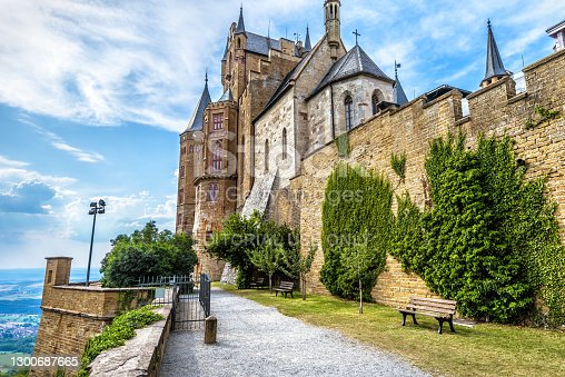 Hohenzollern Castle, Germany, Europe. This castle on mountain top is famous landmark in Stuttgart vicinity, great German monument. Scenery of Gothic castle walls overgrown by ivy in summer.