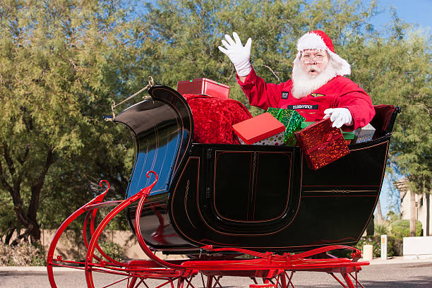 Hohoho Real Santa in Sleigh with Christmas Presents Ho ho ho... Real Santa in Sleigh with Christmas Presents flight suit stock pictures, royalty-free photos & images