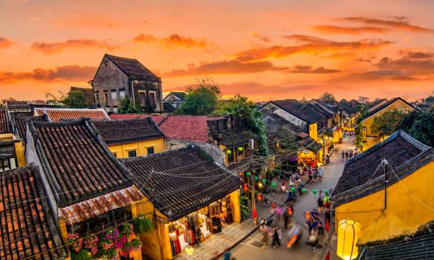 Hoi An, Vietnam: High view of Hoi An ancient town at sunset. Hoi An, Vietnam: High view of Hoi An ancient town at sunset. huế stock pictures, royalty-free photos & images