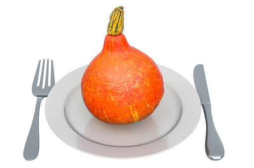 istock Hokkaido pumpkin on plate with fork and knife, 3D rendering isolated on white background 1182512603