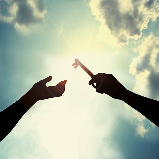 Hold key in sky stock photo