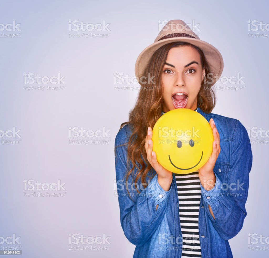 Hold on to your smile and spread the happiness stock photo