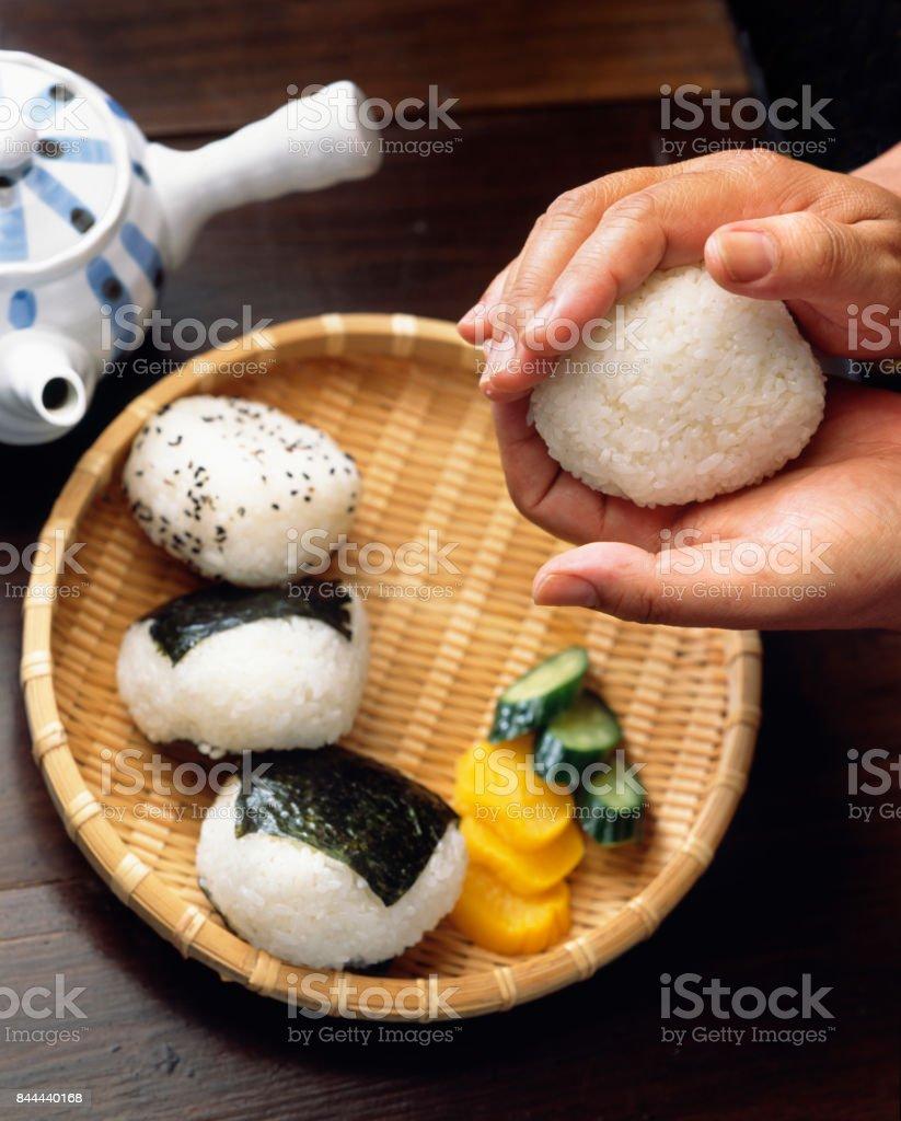Hold the onigiri stock photo